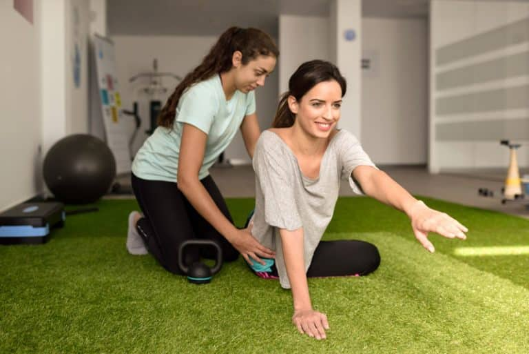 exercise physiologist physical treatment with woman